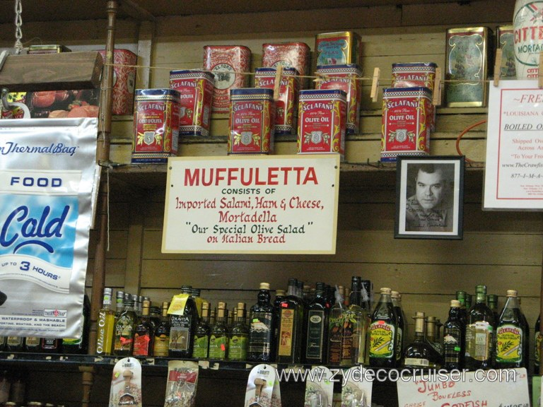 "THE Muffuletta Recipe consists of Imported Salami, Ham & Cheese, Mortadella, ""Our Special Olive Salad"" on Italian Bread"